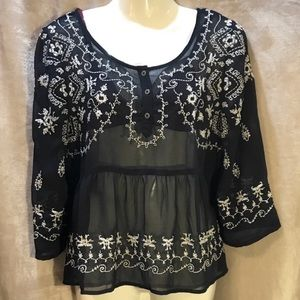Free People sheer black top with white embroidery